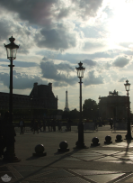 Silhouettes of École du Louvre, the Eiffel Tower, and the Arc de Triomphe du Carrousel